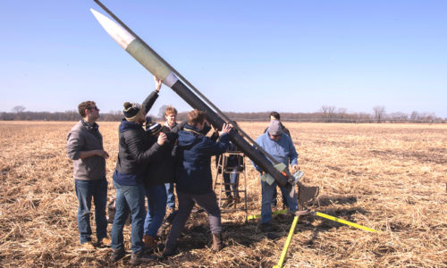 Notre Dame Rocketry Team setting up rocket for a launch