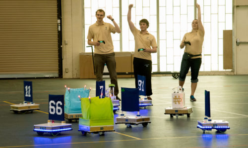 Members of the Notre Dame Robotic Football team celebrating a score