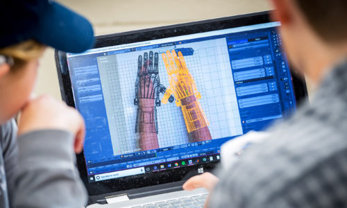 e-NABLE students designing prosthetics on computer