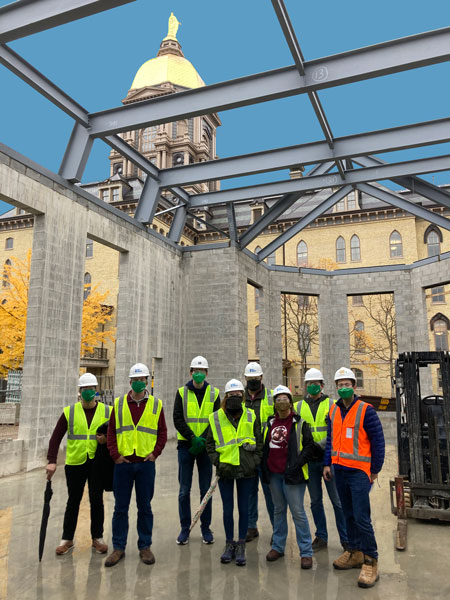 MEng students visit a construction site on campus with Golden Dome in the background