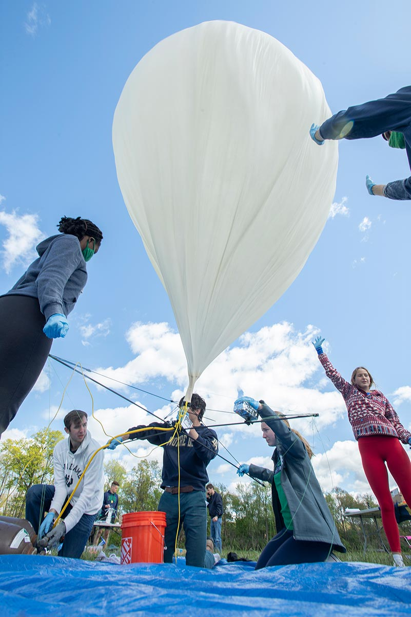 IrishSat Team members filling balloon with helium