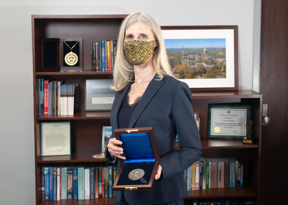 Patricia J. Culligan holding the H. Bolton Seed Medal