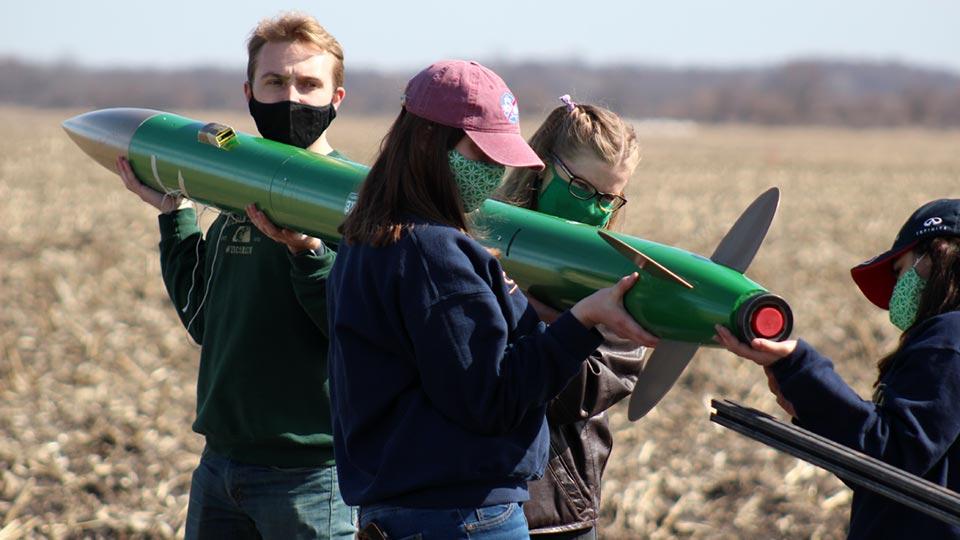 NDRT members inspecting their rocket
